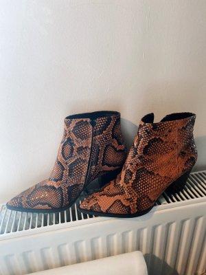 Schlangenlederoptik Boots