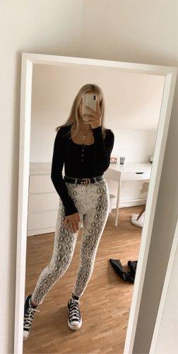 Schlangenmuster Jeans