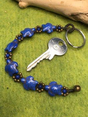 Schlüsselanhänger 3D Schildkröten Blüten Perlen blau gewachste Baumwolle 19,5cm