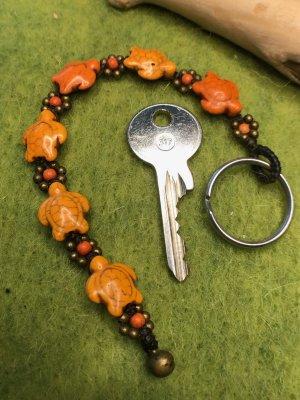 Schlüsselanhänger 3D Schildkröten Blüten Perlen orange gewachste Baumwolle 19,5cm