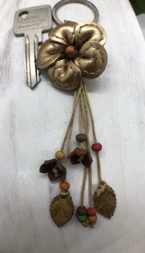Schlüsselanhänger Leder Blüte 4 cm goldfarben 14 cm Länge