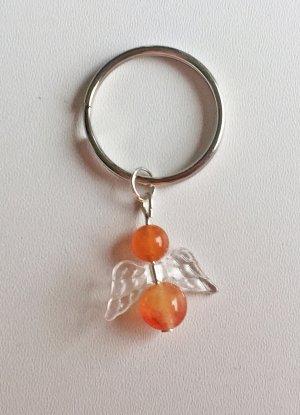 Schlüsselanhänger mit orangenem Schutzengel