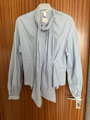 H&M Blusa con lazo azul celeste