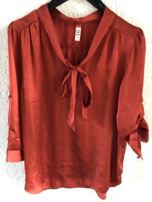Blusa con lazo rojo ladrillo