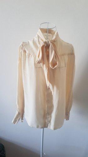 Blusa con lazo crema