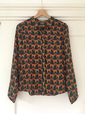 Schöne Bluse mit Fuchsprint