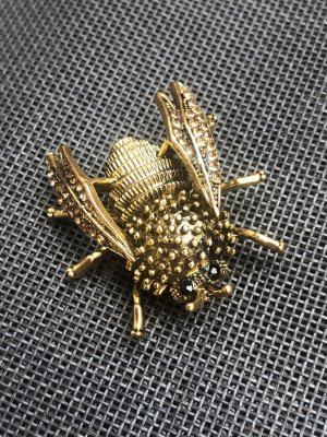 Broche doré-bronze