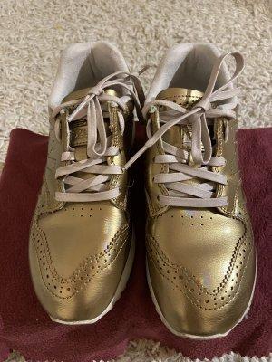 Schöne Gold Sneakers