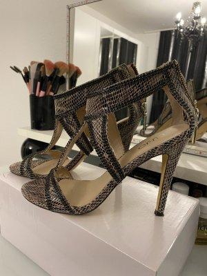 Zapatos de tacón con barra en T negro-marrón