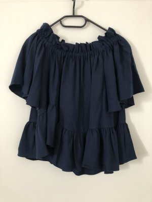 Schöne Off-Shoulder Bluse mit asymmetrischem Schnitt