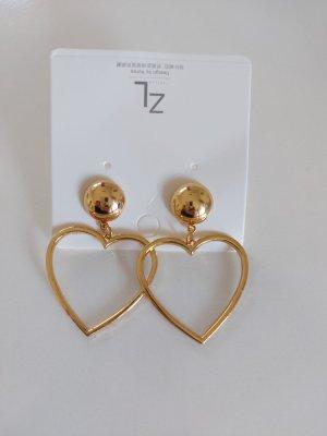 Schöne Ohrringe in Herzform Gold