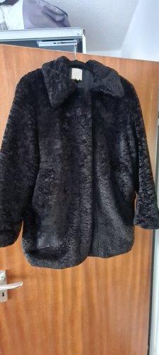 H&M Kurtka ze sztucznym futrem czarny Tkanina z mieszanych włókien