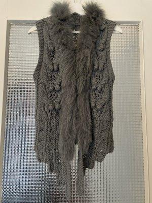 Smanicato lavorato a maglia grigio