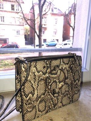 Schöne Tasche mit Schlangenmuster
