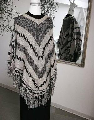 Poncho en tricot noir-beige