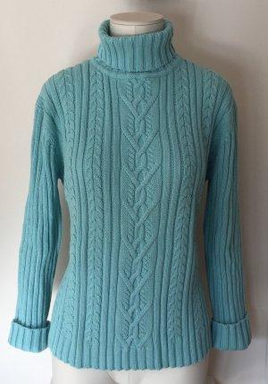 Schöner Rollkragen-Pullover mit Zopfmuster