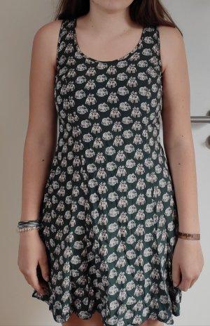 Schönes dunkelgrünes Kleid mit Elefanten