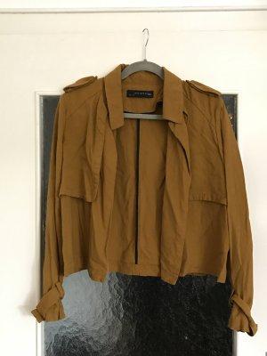 Schönes, offenes, kastig geschnittenes Jäckchen in ocker von Zara Woman.