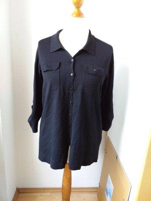 Schönes schwarzes Poloshirt aus fließendem Stoff XL