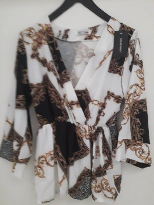 Schößchenbluse im Versace Muster