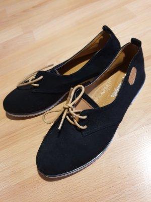 Schuhe aus Kunstleder