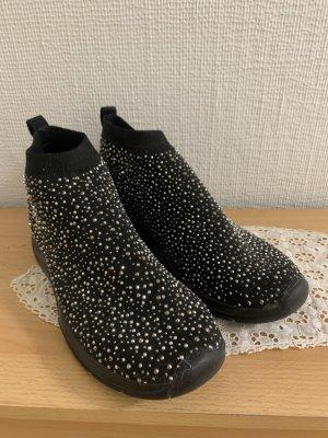 Schuhe voller Siegel