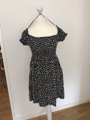 Schulterfreies schwarzes Kleid mit Blumenmuster