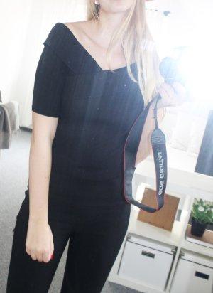 Schulterfreies schwarzes Shirt