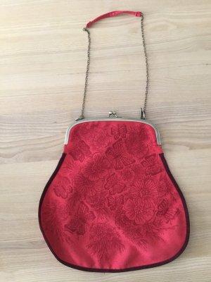 Bolso con correa rojo