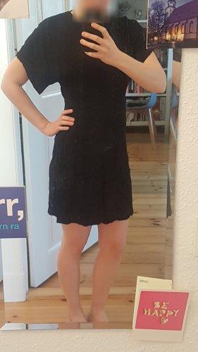 Schwarz glänzendes gemustertes Kleid