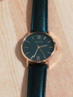 Schwarz goldene Armbanduhr von Tchibo