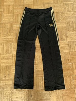 Schwarz, goldene Joggingshose von Adidas