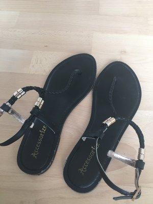 Schwarz-goldene Sandalen