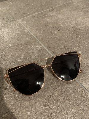 Schwarz goldene Sonnenbrille