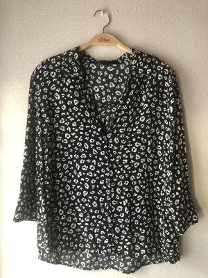 Schwarz/weiß gemusterte Bluse