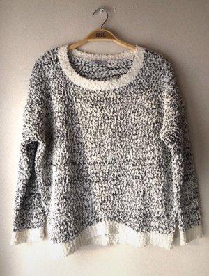 Schwarz/weiß gepunkteter Pullover