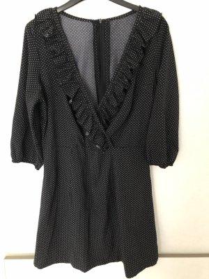 Schwarz weiß gepunktetes Kleid mit Volants 40