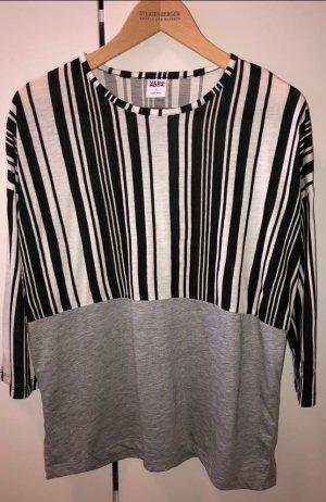 Schwarz/Weiß liniertes graues Langarmshirt