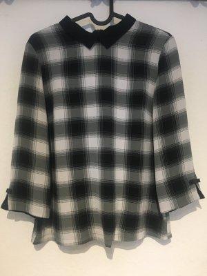 Schwarz-weiße Bluse mit Kragen