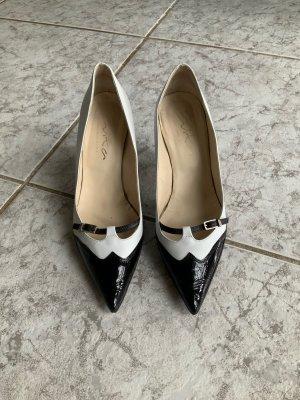 Schwarz-weiße Evita Pumps