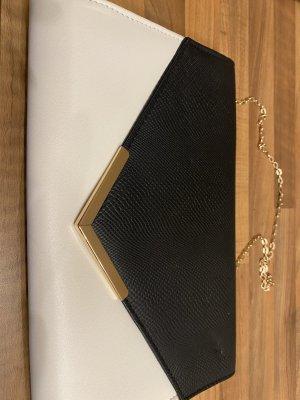 Schwarz weiße Handtasche mit goldener Kette