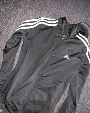 Schwarz, weiße Strickjacke von Adidas.