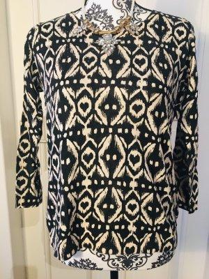 Schwarz weißer Pullover mit Glitzersteinen