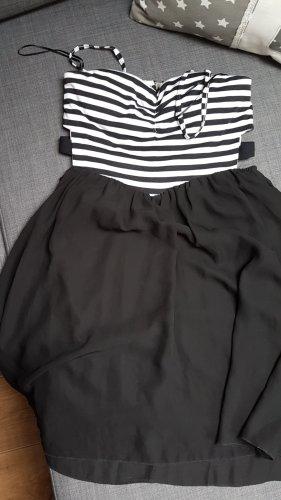Schwarz-weißes Corsagenkleid mit Cut-Outs an der Taille