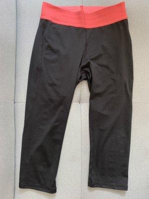 Schwarze 3/4 Sporthose mit Bündchen in Pink