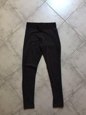 Schwarze Adidas Leggings mit Streifen an den Waden
