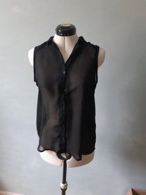 schwarze ärmellose Bluse