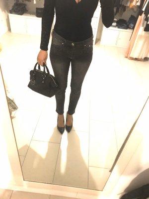 Schwarze Biker Jeans