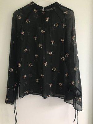 schwarze Blumenblumse transparent