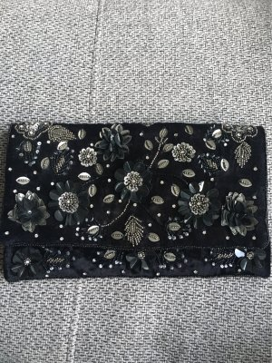 Schwarze Blumenclutch